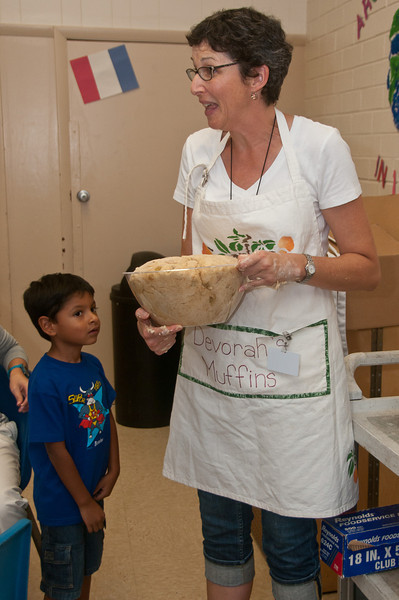 Debbie Sokobin demonstrates how much the dough has risen.