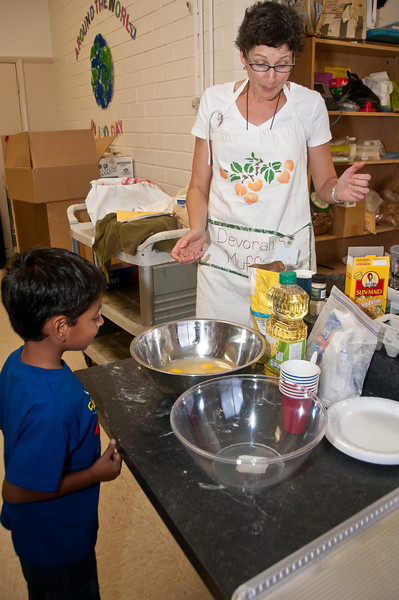 Debbie Sokobin checks the egg mixture as Diego Meneses (4 years old from Germantown) looks on.