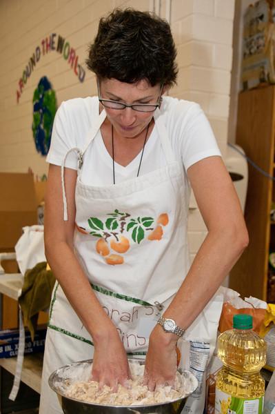 Debbie Sokobin mixes the heavy dough by hand.