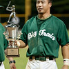 Mason Morioka accepts the championship trophy on behalf of the Big Train team.