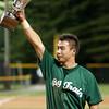 Mason Morioka accepts the championship trophy on behalf of the Big Train team.