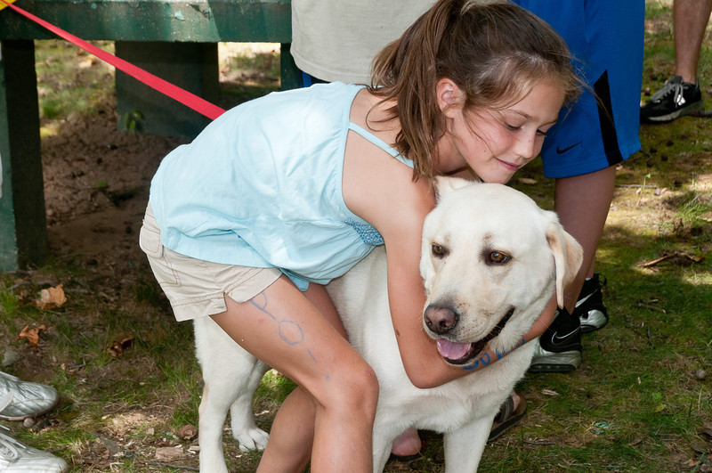"Kate Quigley (7 years old, Potomac El) and the Quigley's dog ""Cooper""."