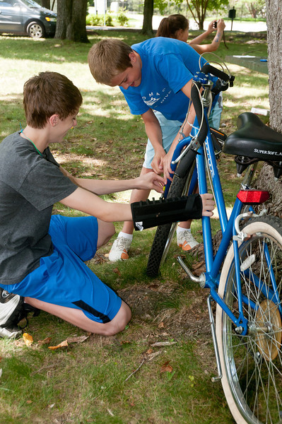 Erik Johnson (14 years old incoming Churchill freshman) and Jack Quigley (12 years old, Hoover) disassemble a bike so it can be shipped to people around the world.