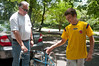 Conor Quigley (14 years old) accepts the bike donation from Mike Tuckman.