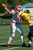 Chris Aust of Bullis gtets to Saints QB Myles Nelson.