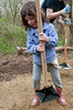 Naomi Colflesh, 7 years old, compacts the sand on the path being constructed by volunteers.