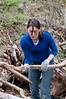 India Drew removes dead tree limbs.