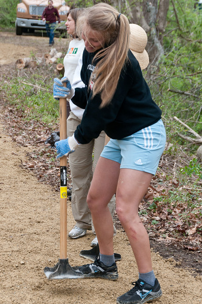 Maria Giordano, a student at American University, conpacts the sand on the path being constructed.