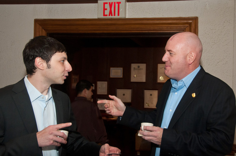 Jason Goldberg and Mark Livingstone, both Sargents with the Cabin John Park Fire Department, enjoy small cups of soup as they carry out an animated discussion.