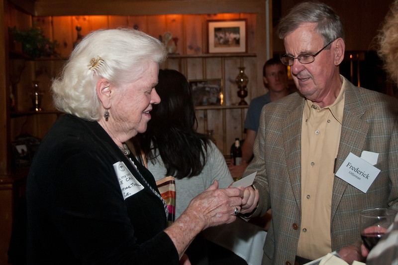 Elie Cain of the Potomac Theatre Company receives a business card from Frederick Offermann of LTC Insurance Annuities of Potomac