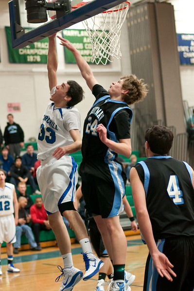 Kyle Edwards of Churchill drives to the basket as Whitman's Nick Yockey defends.