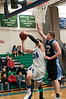 Jesse Simon of Churchill drives to the basket as Whitman's Daniel Vligt defends