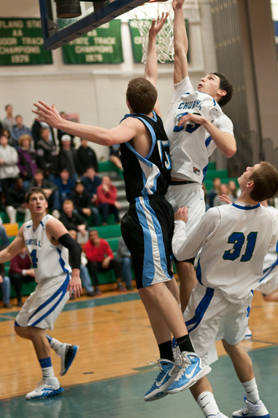 Daniel Voigt of Whitman throws up a layup that Churchill's Kyle Edwards tries to block.