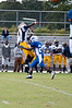 Aik Davis gets to the quarterback just as the ball is released.