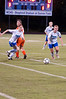 Laura Langbergman (17) and Zoe Forster (14) go after the ball.
