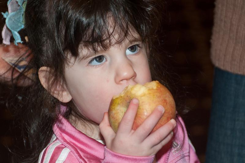 Alexa Freeman, 3 years old, eats an environmentally friendly (and good tasting) apple.