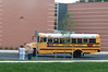 School bus drives into the parking lot of the newly opened Cabin John Middle School.