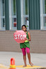 Dalya Arik (10 years old) directs traffic in front of Bells Mill ES.