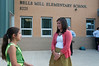 Dalya Arik (10 years old) talks to 5th grade teacher Loren Kemp in front of Bells Mill ES.