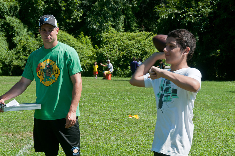 Former Whitman starting QB, Henry Kuhn, grades the camp participants in throwing accuracy.