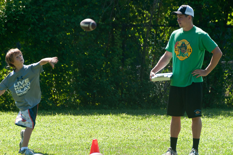The coach's son, Henry Kuhn, tests the participants on their throwing accuracy.  Henry was the Whitman starting QB before graduating in June.