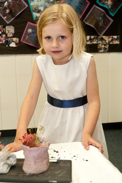 Skyler Struzziero, 5 years old, looks at her sculpture.