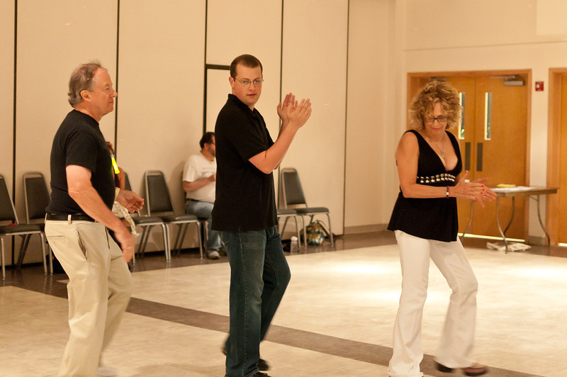 Ben Hole, Ari Atkinson, and Tanya Buchman clap and dance.
