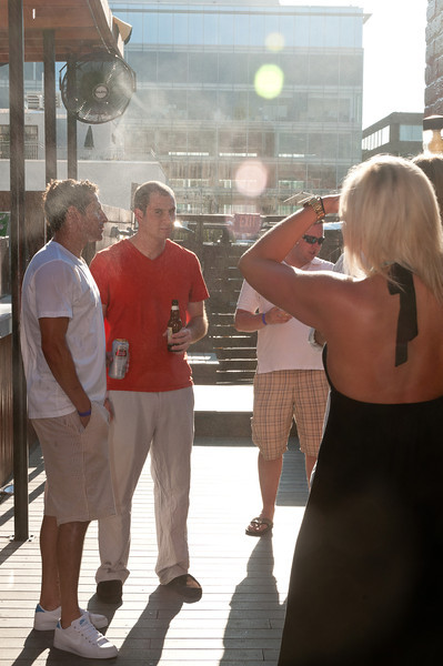 It was so hot on the roof terrace that a fine mist was blown by fans to cool the guests.