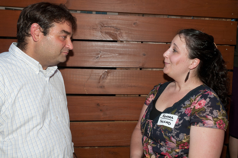 Danny Kirsch (Jewish Community Relations Council) talks with Kendra Rubinfeld (Yachad).
