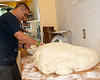 The risen dough (about 73 pounds) is put on the shaping board where it will be divided into 42 loaves.