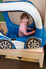 "Savannah Entin, 4 1/2 years old, has fun driving the inflated ""car""."
