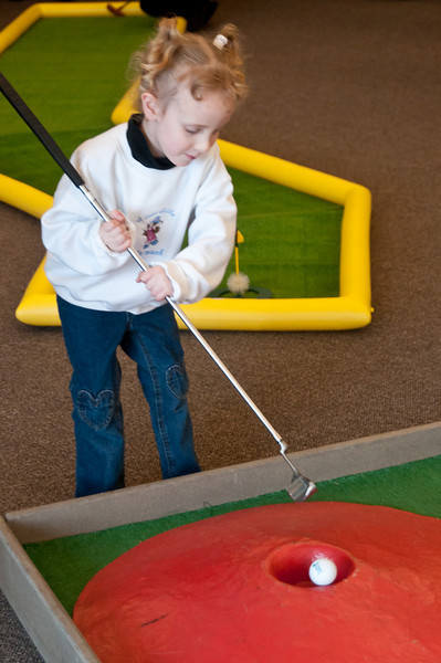 Shyanne Weisman, 4 years old, knocks the ball in the hole.