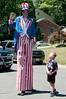July 4th at River Falls: A tall Uncle Sam and 6 year old Ryan Caudron