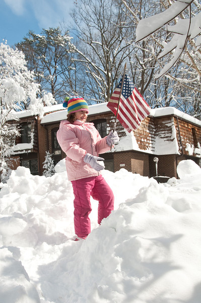 Winter 2010 in Potomac (Inverness Forest): Seven year old Ilana Trembisky claims a snow mountain fort for the United States.