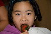 Potomac Strawberry Festival at Potomac United Methodist Church--Lisa Leung eats a chocolate Strawberry