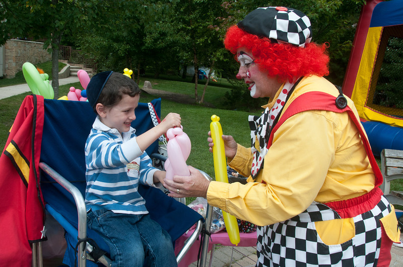Baruch Milikowsky (5 years old from Olney) asked Candy Cane the clown to make him a bow and arrow from balloons. Baruch is the gradson of Rabbi Milikowsky from Ohev Sholom Talmud Torah Congregatgion of Olney.