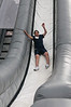 Sammy Saka (13 years old from Olney) demonstrates to the younger children how to safely go down the slide.