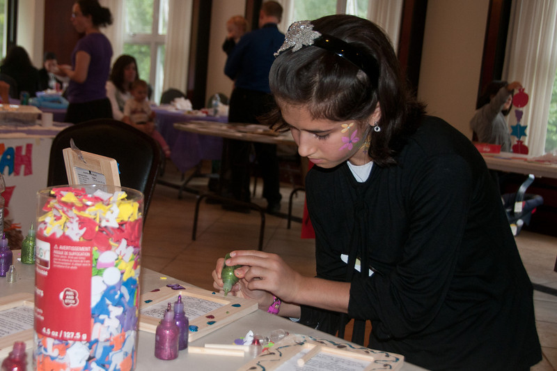 Hinda Meth (10 yrs old from Baltimore) puts the finishing touches on a Rosh Hashanah project.