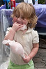 Sarah Soloveichik (2 years old from Aspen Hill) enljoys the cotton candy.