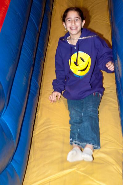 Gabi Riffkin (8 yers old) goes down the slide.