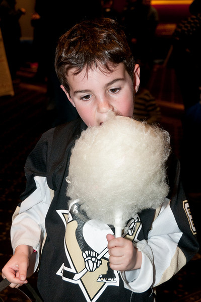 Eight-year old Jake Freeman samples the cotton candy.