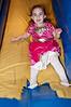 Three-year old Aviva Stern goes down the slide.
