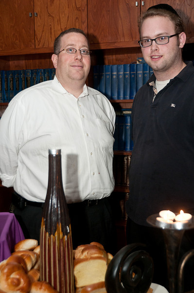 Avrohom Klainberg (the mashgiach) and Sincha Gross (the caterer) with some of the food they provided for the event.