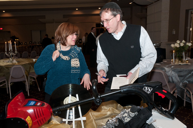 Michelle and Martin Swartz discuss whether to try for the snow blower.