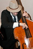 Michael Singer provides background Jazz on the double bass.