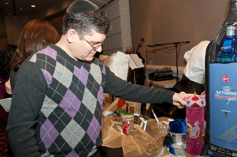 Eli Rutstein is impressed with the Megillah holder.