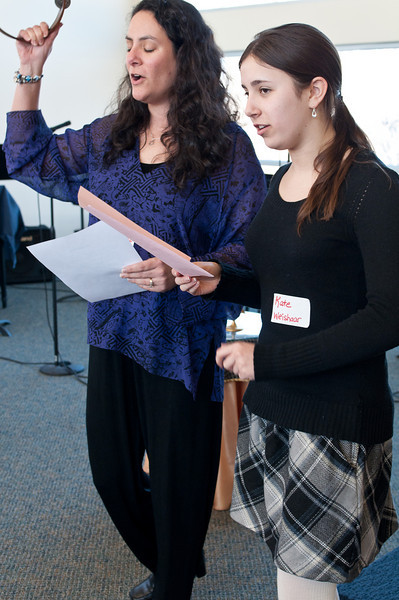 Stephanie Weishaar, along with her daughter Kate, lead the singing. Kate is 14.
