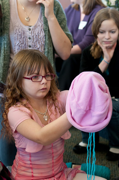 Mikayla Cary, aged seven, begins decorating a hat.