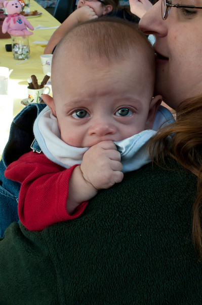 It's tough being the old male guest at the Woman's Tea.  Six month old Jason is comforted by his mother, Andrea Levy.