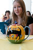 Sarah Tew, 14 years old,looks over  a beautiful hand painted teapot that is only used for the annual Women's Tea.